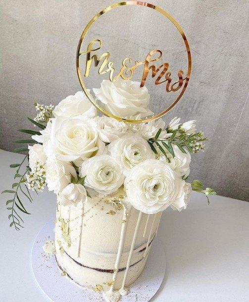 Abundant White Rose Basket Wedding Cake