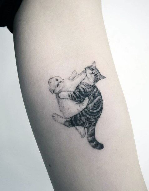 Adorable Fighting Pair Of Cats Tattoo For Women On Hands