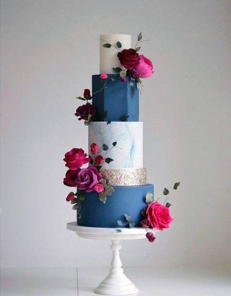 Alternating Blue And White Wedding Cakes With Red Roses