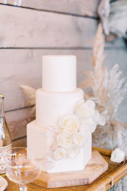Angled And Circular White Wedding Cake