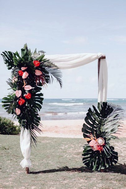 Angled Arch Wedding Decor With Tropical Flowers