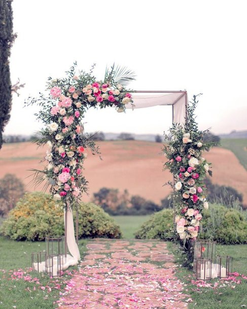 Angular Arch With June Wedding Flowers