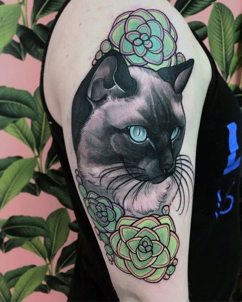 Azure Blue Eye Cat And Green Rose Tattoo For Women On Arms