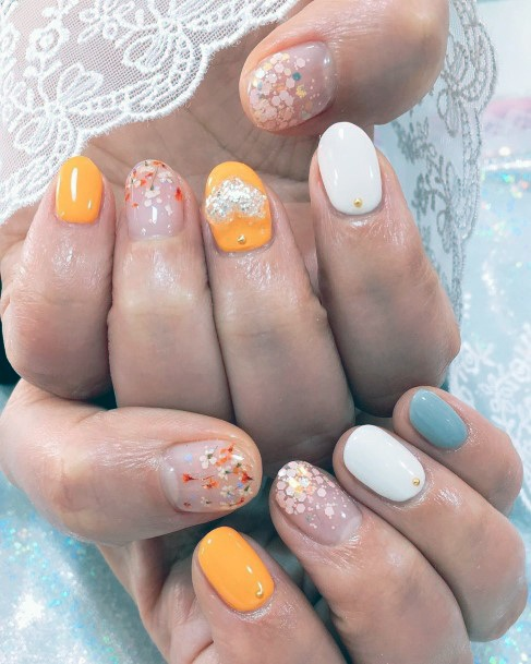 Baby Flower Designs On Colored Nails