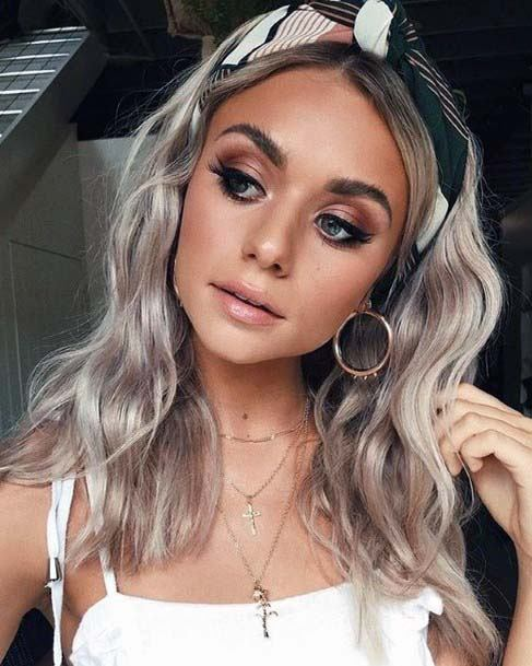 Beautiful Female With Icy Blonde Wavy Hair Pulled Back With Scarf Headband