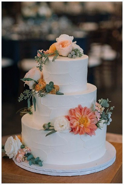Beautiful White Tiered Cake With Full White And Orange Floral Wedding Cake Ideas