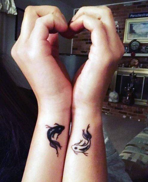 Black And White Fish Tattoo Womens Wrist