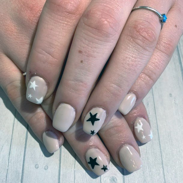 Black And White Star Pattern On Nude Nails For Females