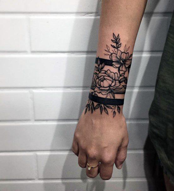 Black Ribbon Tied Wrist Tattoo With Florals Women