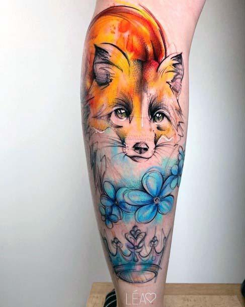 Blazing Fox Blue Flowers And Crown Tattoo Womens Legs