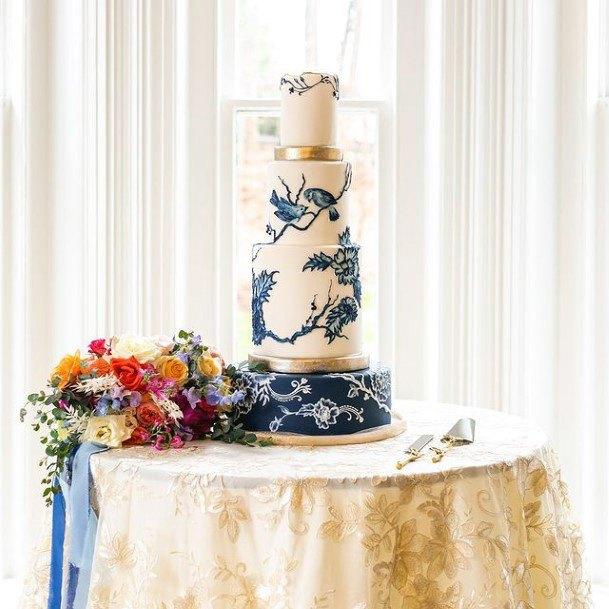 Blue Floral Art On White Wedding Cake