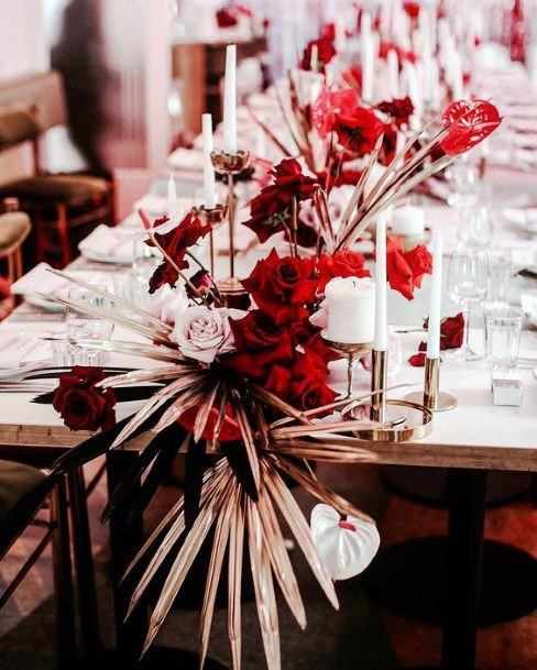 Bohemian Feather And Red Florals Wedding Centerpiece Ideas