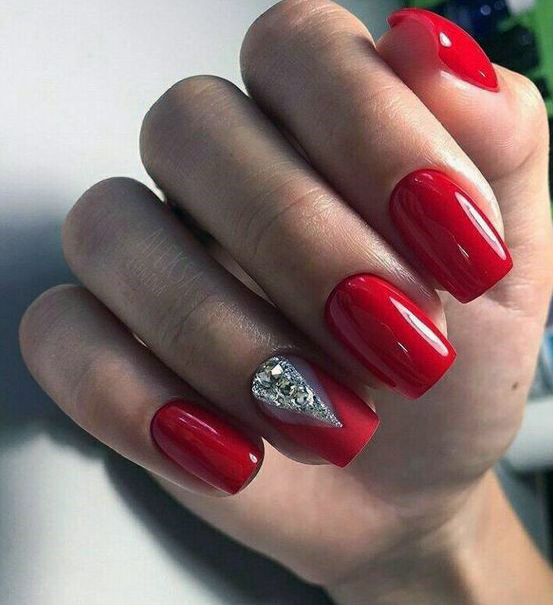 Bold And Bright Red Nails With Triangular Silver Design For Women