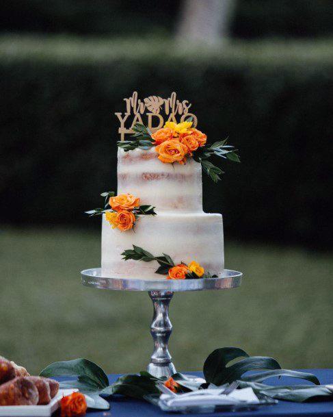 Bold Yellow Hawaiian Wedding Flowers On Cake