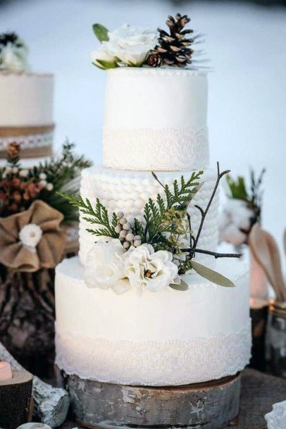 Breathtaking White Cake Christmas Wedding Flowers
