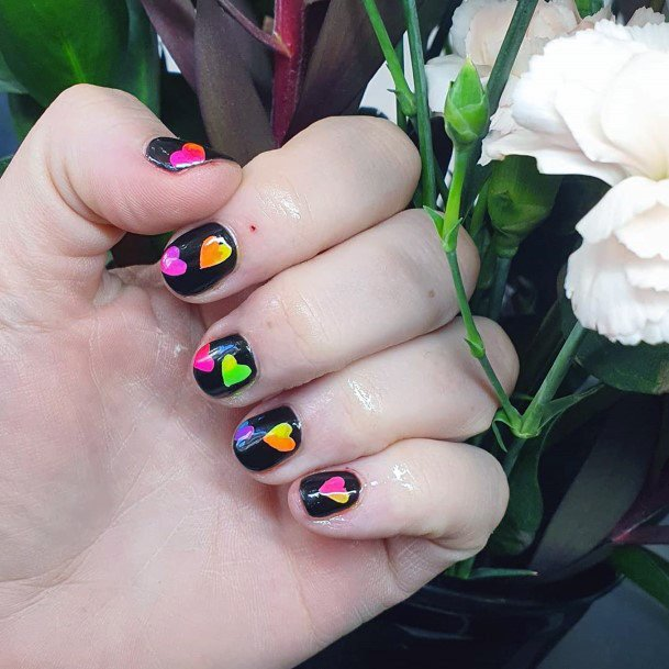Bright Colored Hearts On Black Colored Nails For Women