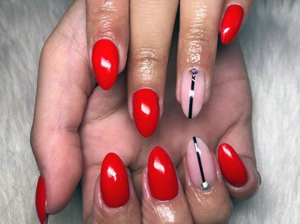 Bright Red Nails With Golden Lined Design For Women
