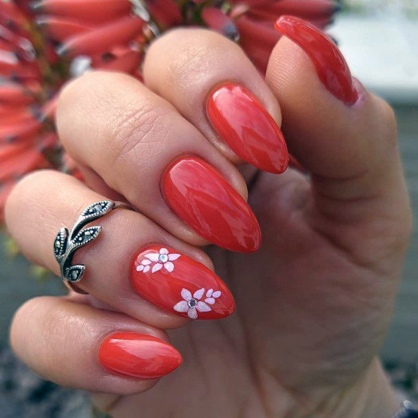 Bright Red Nails With White Blossom Accent For Women