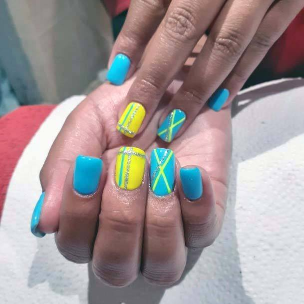Bright Yellow And Blue Nails Cross Design For Women