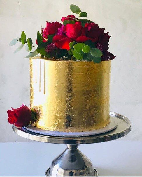 Bunch Of Red Roses On Golden Cake