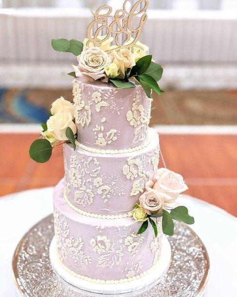 Butter Toned Flowers On Purple Wedding Cake