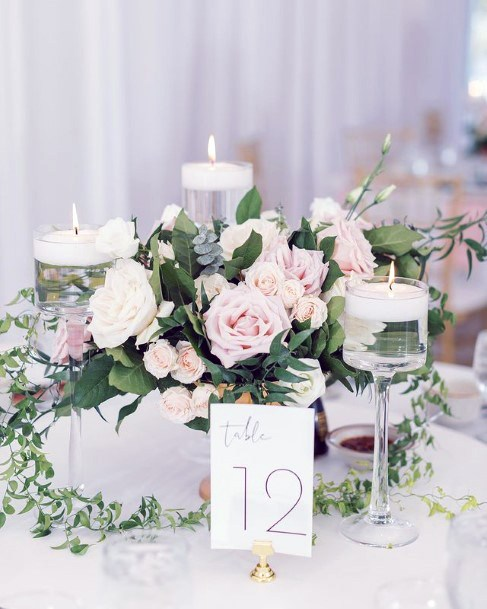 Candles And Blush Flowers Wedding