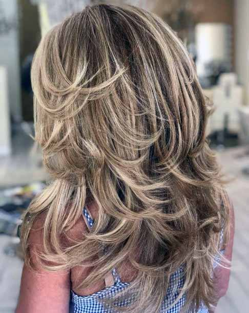 Cascading Ash Colored Hairstyle Women