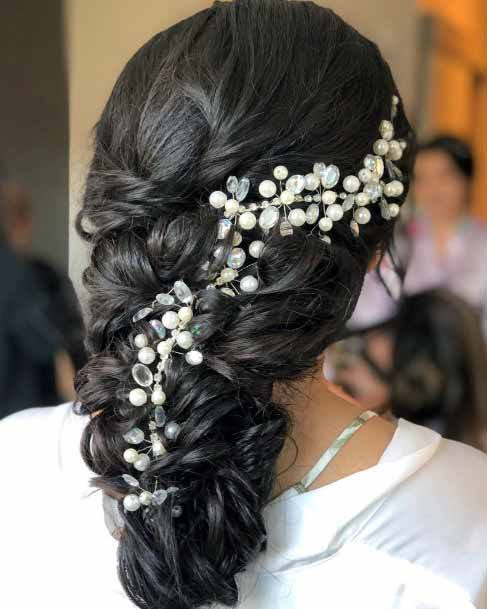 Cascading Dark Curls With Pearls Hairstyle Women