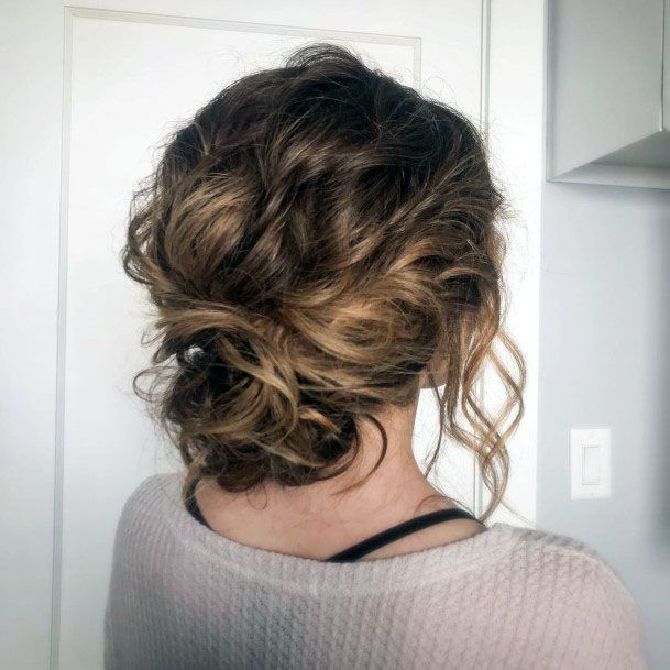 Chignon With Loose Tendrils Hairstyle For Women