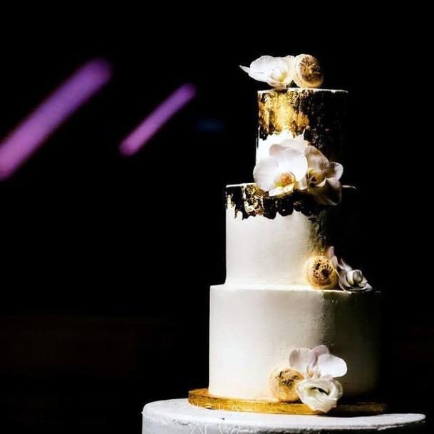 Classy White And Gold Wedding Cake