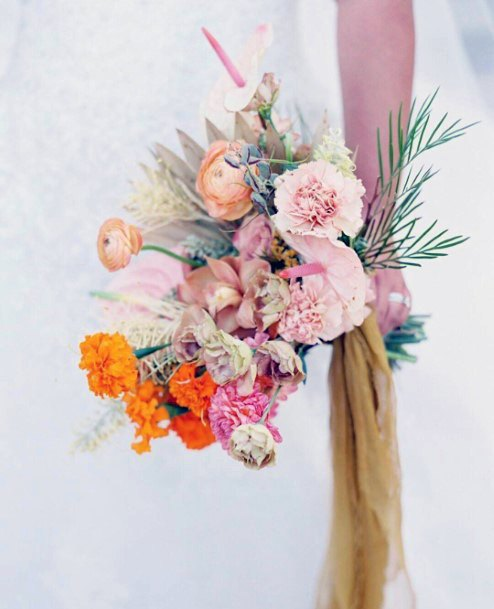 Cluster Of Yellow And Pink Wedding Flowers