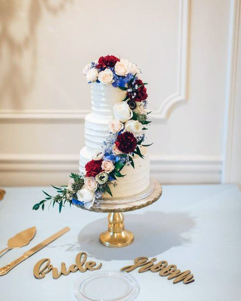 Colored Rose Creepers On 3 Tier Wedding Cake Women