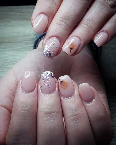 Colorful Glitters And Feathered Plant Art On Nude Nails For Women