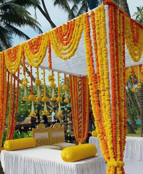 Couple Couch Decorated With Marigold Flowers Indian Wedding