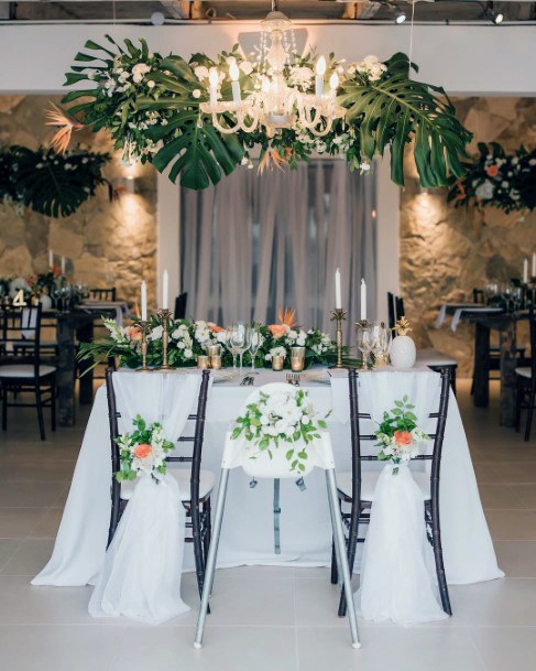 Couple Couch Tropical Wedding Flowers