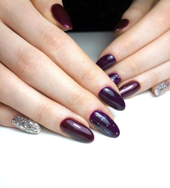 Dark Purple Colored Almond Nails