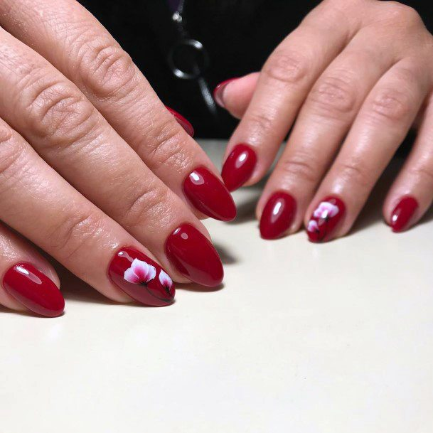 Dark Rich Red Shellac Nails With White Floral Accent For Women