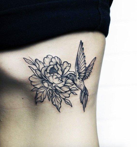 Deep Black Flower And Hummingbird Tattoo Torso