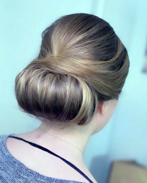 Deftly Tucked In Golden Chignon Hairstyle For Women