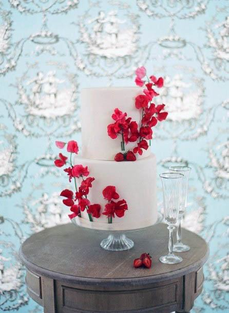 Delightful Red Flowers On White Cake