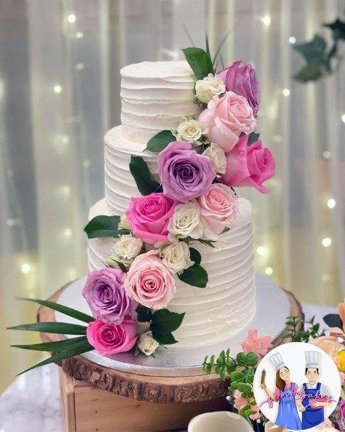 Delightful Roses On 3 Tier Wedding Cake Women