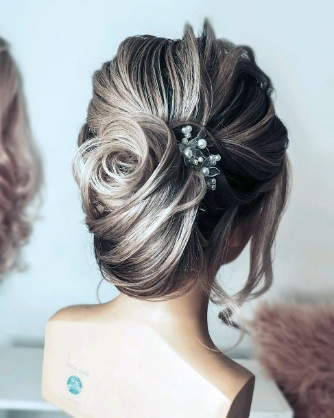 Demonstration Of A Loose Bridal French Twist For Women