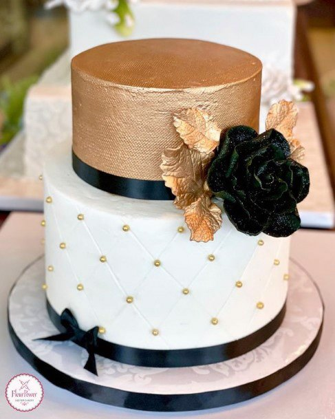Designer Gold And White Wedding Cake With Black Rose