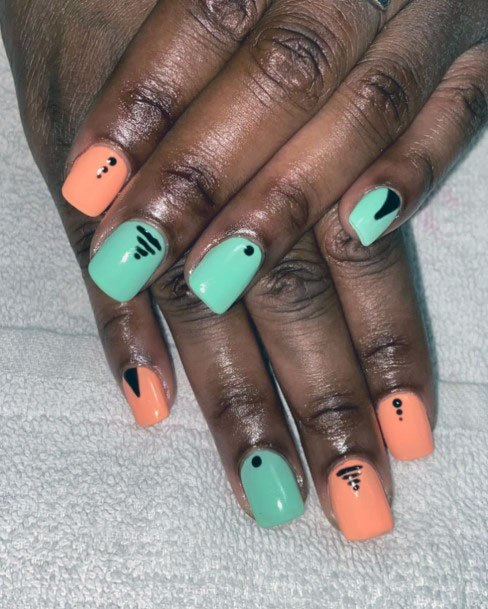 Dots And Scribbles Light Orange And Pistachio Colored Nails