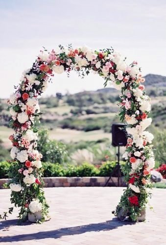 Enchanting Red And White June Wedding Flower Arch