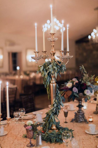 Fairy Tale Candlestick With Cascading Greenery Wedding Centerpiece Ideas
