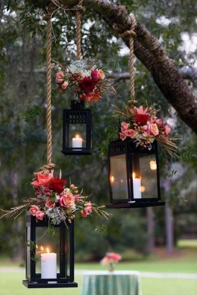 Fall Wedding Ideas Hanging Lanterns With Red And Range Flowers Backdrop Fall Wedding Ideas