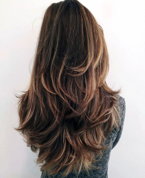 Female With Airy Chestnut Blonde Long Hair And Slight Wave Throughout