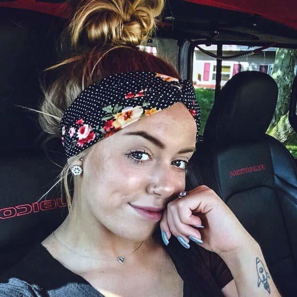 Female With High Hair Knot And Black Polka Dot Headband