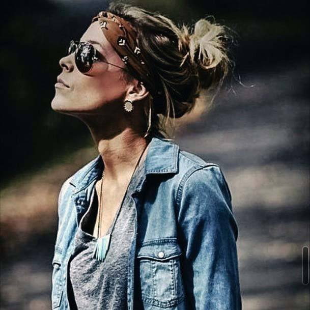 Female With Messy Bun And Brown Headband